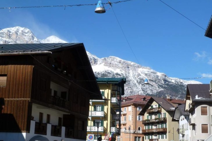 View from the streets of Cortina d'Ampezzo towards the mountains.